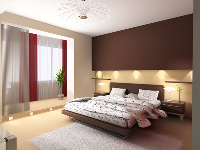 Modern interior of a bedroom with illumination of a bed